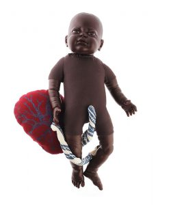 Fetal doll brown with placenta